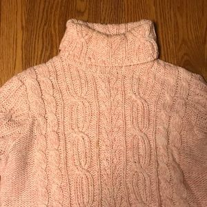 Light pink turtleneck cable knit sweater